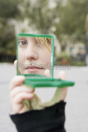 reflection of a young woman in
