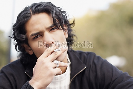 portrait of a young man smoking