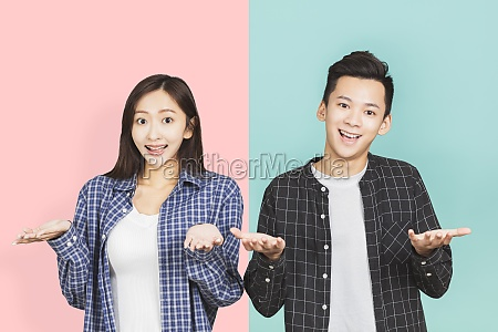 young asian couple having confused looks