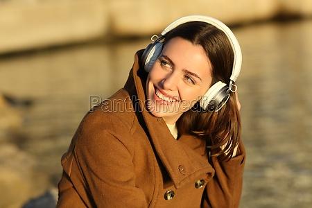 woman wearing headphones listenng to music