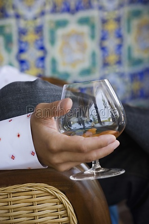 close up of man holding glass