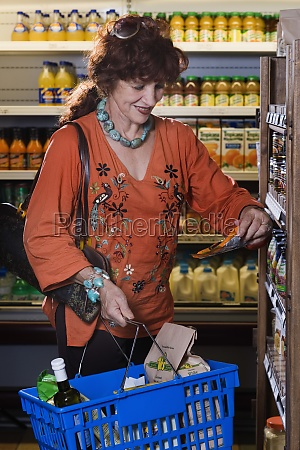 senior woman shopping at grocery store