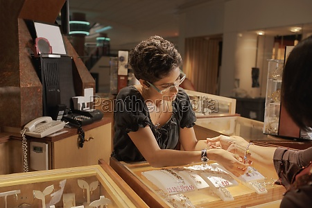 sales girl at jewelry store helping