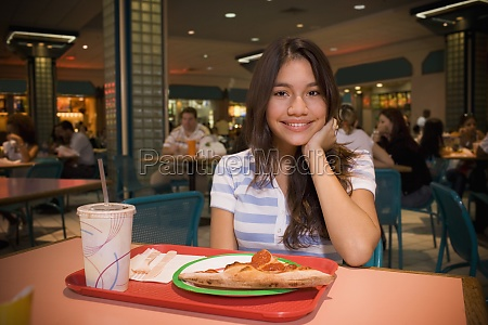 teenager sitting in mall food court