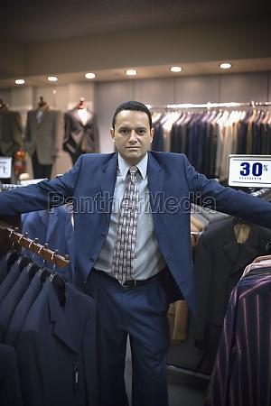 sales associate in menswear store in