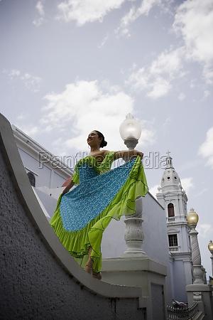 teenaged girl wearing plena traditional attire