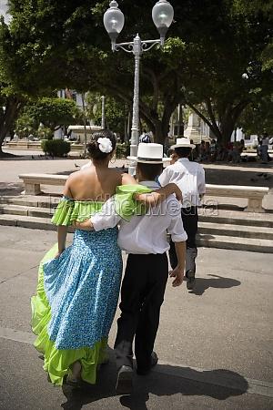 children wearing traditional plena attire embracing
