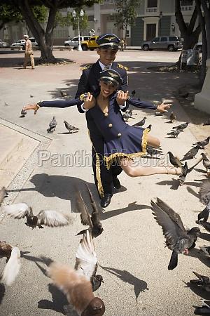 children wearing pilot and flight attendant