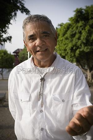portrait of senior man gesturing with