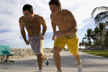 two friends race each other at