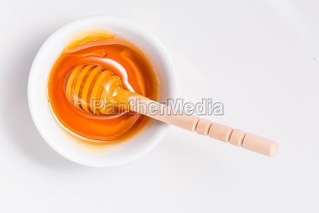 honey with wooden honey dipper on