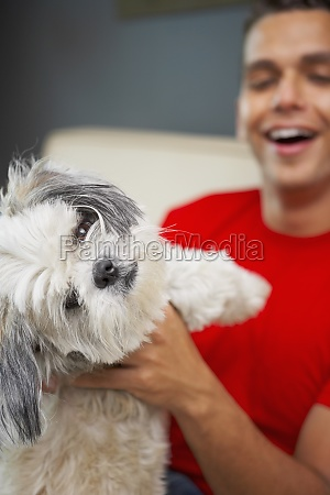 young man playing with his pets