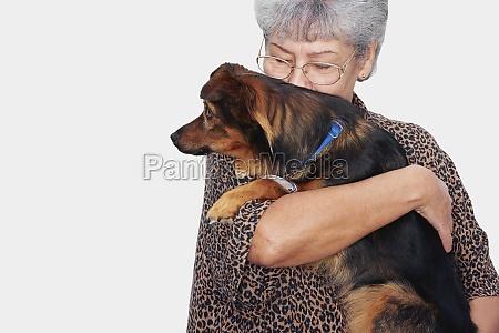 senior woman kissing her pets