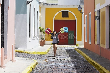 young woman carrying shopping bags old
