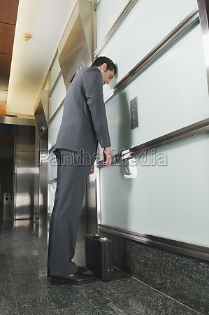 businessman standing in a corridor and