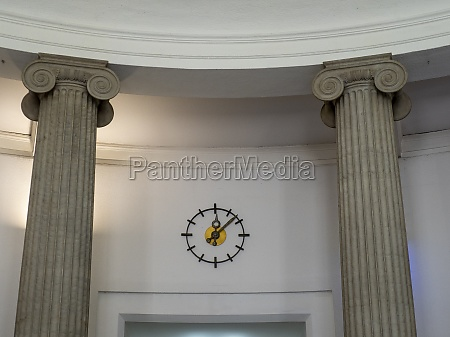 entrance hall with clock and ionic