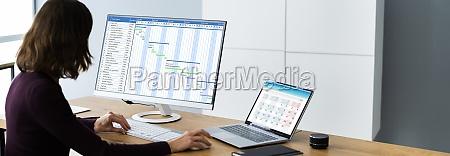 businesswoman working on gantt chart using