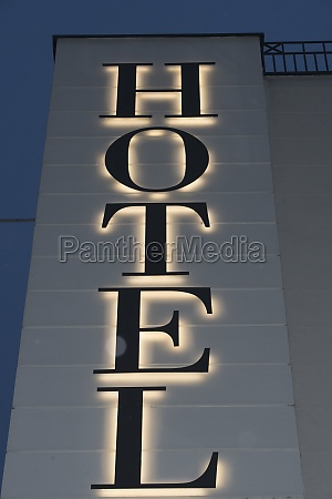a hotel sign in tourism