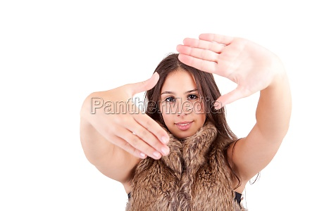 young woman showing framing hand gesture