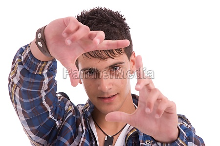 young man showing framing hand gesture