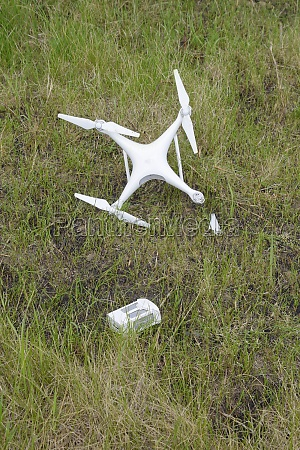the crashed drone dirty and in
