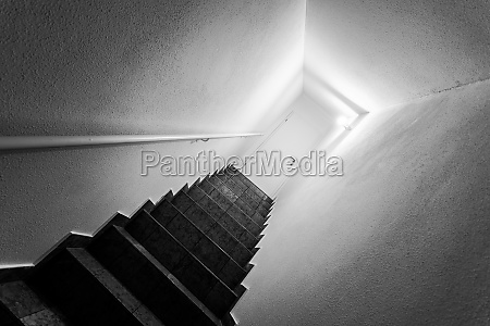basement stairway with railing white door