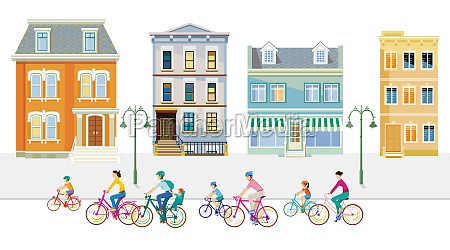 cyclists in the suburb with apartment