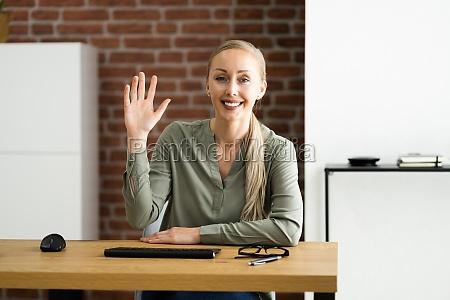 woman portrait waving to webcam