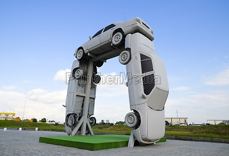 homemade sculpture of three cars monument