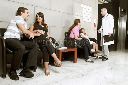patients and a doctor in a