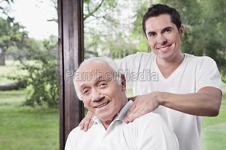 massage therapist massaging a manZs neck