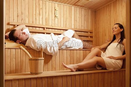 couple taking a sauna bath