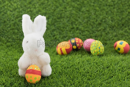 easter bunny toy and easter eggs
