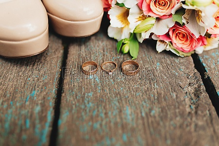 wedding rings shoes and bouquet on