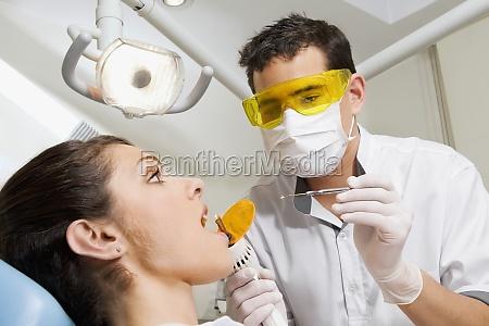 dentist examining a womanZs teeth