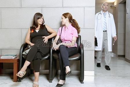 two women sitting in a hospital