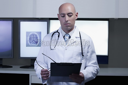 doctor examining a medical report