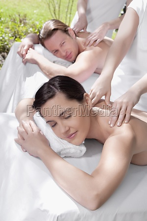 couple receiving back massage from massage