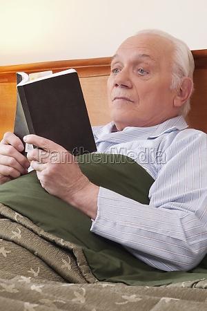 man reading a book in nursing