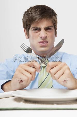 portrait of a businessman refusing dinner