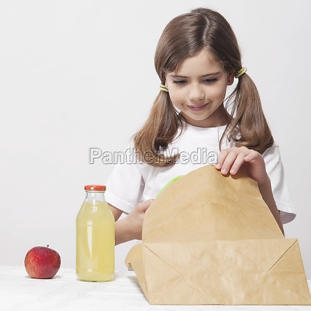 girl packing lunch for school