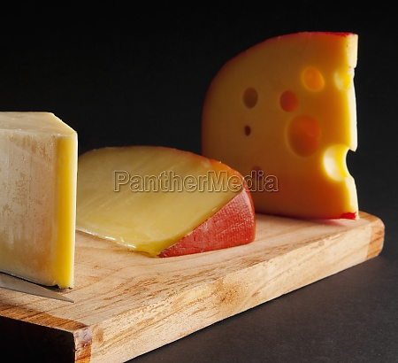 assorted cheeses on a cutting board
