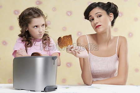 woman giving her daughter a burnt