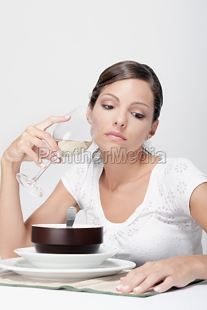 woman drinking white wine and thinking