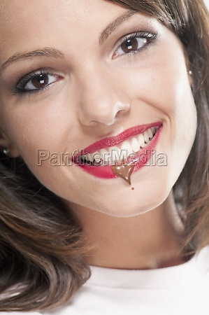 chocolate drop on a womanZs lip