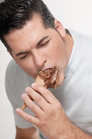 closeup of a man eating an
