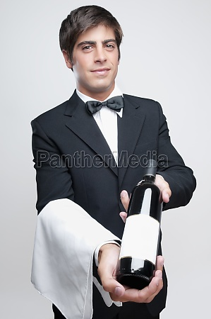 portrait of a waiter holding a