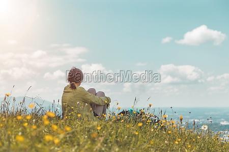 enjoying the idyllic mountain landscape girl