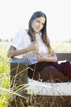 businesswoman sitting on a sofa and