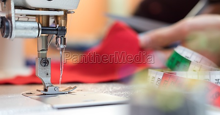 sewing in a tailor workshop close